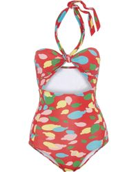 Isolda - Cutout Shirred Printed Halterneck Swimsuit - Lyst