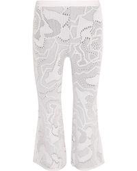 Hervé Léger - Cropped Crochet-knit Bootcut Trousers - Lyst