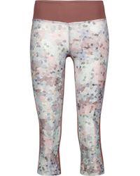 Koral - Emulate Cropped Paneled Printed Stretch leggings - Lyst