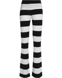 Norma Kamali - Striped Stretch-jersey Flared Trousers - Lyst
