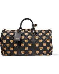 Moschino - Leather-trimmed Quilted Printed Shell Duffle Bag - Lyst
