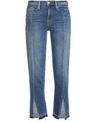 FRAME - Frayed Faded Mid-rise Slim-leg Jeans - Lyst
