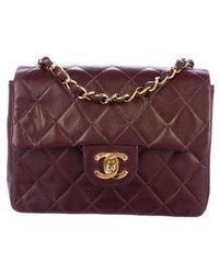 88e0f9f3958aa1 Lyst - Chanel Quilted Satin Mini Square Flap Bag Black in Metallic