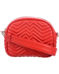 Maje - Chevron Quilted Crossbody Bag Gold - Lyst