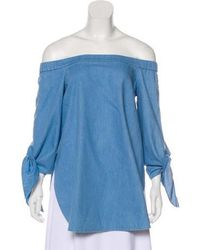 39abb05c96771 Lyst - Tibi Off-the-shoulder Chambray Top in Blue