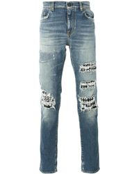 Saint Laurent - Studded Distressed Jeans - Lyst