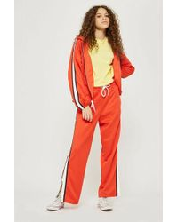 TOPSHOP - Tall Orange Popper Track Trousers - Lyst