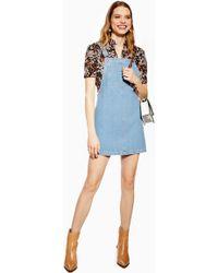 8b2dadb438c TOPSHOP - Denim Pinafore With Bib Pocket Dress - Lyst