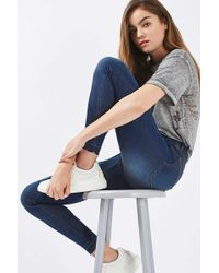 TOPSHOP - Moto Let Down Hem Leigh Jeans - Lyst