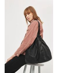 TOPSHOP - Leather Drawstring Tote Bag - Lyst