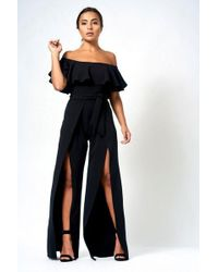 191a32dd130c Club L cross Back Crepe Detail Jumpsuit By in White - Lyst
