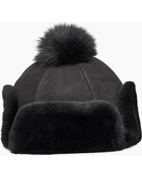 db8a01163bf4a UGG Flap Shearling Hat in Black - Lyst
