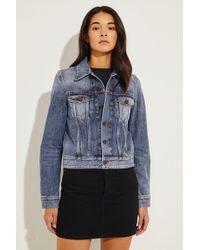 Saint Laurent - Jeansjacke mit rückseitigem Logo Blau 100% Baumwolle Größe des Models: 175 cm Made in Italy - Lyst