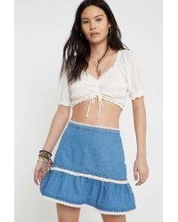 cd2b3ff5f TOPSHOP. Urban Outfitters - Uo Tilly Lace Trim Flippy Denim Mini Skirt -  Lyst
