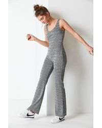 2d8adc9a984 Urban Outfitters - Uo Plaid Flare Bodycon Jumpsuit - Lyst