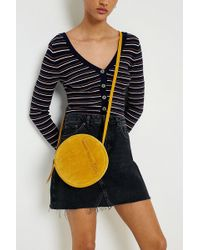 Urban Outfitters - Uo Mustard Suede Round Crossbody - Lyst