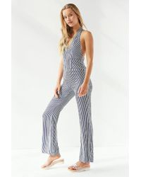 Urban Outfitters - Uo Shiloh Plunging Flare Jumpsuit - Lyst