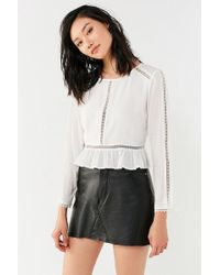 11e2824e09af15 Lyst - Urban Outfitters Kimchi Blue Lace Up Ruffle Cropped Blouse in ...