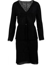 Chanel - Pre-owned Black Wool Jumpsuits - Lyst