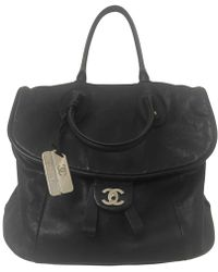 Chanel - Black Leather Travel Bag - Lyst