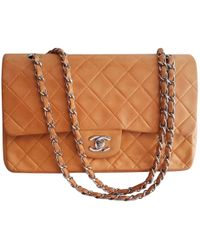 Chanel - Pre-owned Timeless Yellow Leather Handbags - Lyst