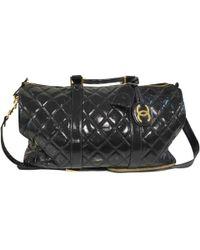 Chanel - Vintage Black Leather Travel Bag - Lyst