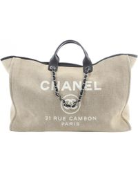 Chanel - Deauville Beige Cloth Travel Bag - Lyst