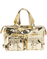 MCM - Pre-owned Gold Leather Handbags - Lyst