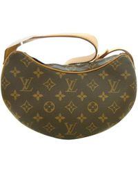 c552adbaf256 Louis Vuitton - Pre-owned Croissant Brown Cloth Handbags - Lyst