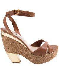 2dccef96ee7 Lyst - Miu Miu Leather Laceup Wedge Sandals in Brown
