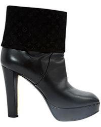 À découvrir   Bottes à talons Louis Vuitton femme à partir de 250 € a34503e943c
