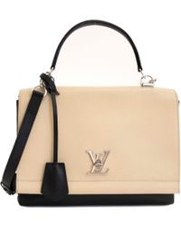 88f3242a3edd Louis Vuitton - Pre-owned Lockme Black Leather Handbags - Lyst