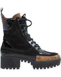 379f67df5bf6 Lyst - Women s Louis Vuitton Boots