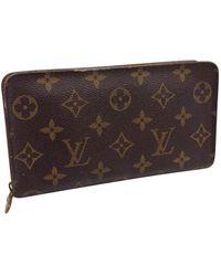 Louis Vuitton Zippy Brown Cloth Wallets