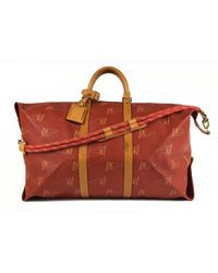 Louis Vuitton - Pre-owned Vintage Keepall Red Cloth Bag - Lyst