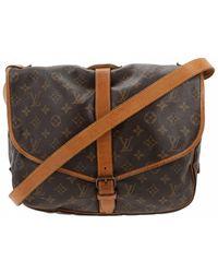 Louis Vuitton - Pre-owned Vintage Saumur Brown Cloth Handbag - Lyst a0d50e0799dd5