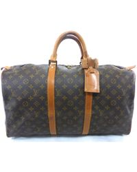 a46c24d2e64b Louis Vuitton - Pre-owned Vintage Keepall Brown Cloth Travel Bag - Lyst