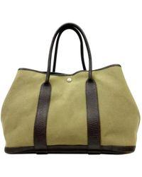 0335b9e0d9e9 Hermès - Vintage Garden Party Brown Cloth Handbag - Lyst