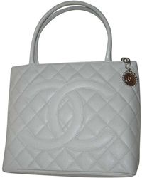 Chanel - Pre-owned Vintage Médaillon Grey Leather Handbags - Lyst