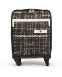 Chanel - Pre-owned Black Tweed Travel Bags - Lyst