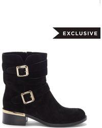 025b221e01da Lyst - Women s Vince Camuto Flat boots On Sale