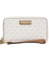 a083a60aaf8e Lyst - Michael Kors Honey Leather Wallet in Pink