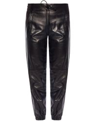 a7bca8ff39 Lyst - Saint Laurent Low-Rise Skinny Faux-Leather Trousers in Black