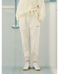 ANOTHER A - Side Zipper Jogger Trousers White - Lyst