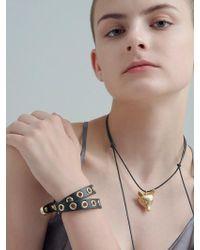 VIOLLINA | Another V Metal Punching Bracelet | Lyst