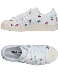 lyst adidas originals niedrigen tops & turnschuhe in weiß