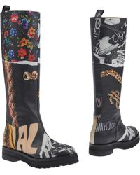 63f5e23eebd Lyst - Women s Moschino Knee boots On Sale