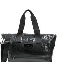 791c6ae137be adidas By Stella McCartney Ship Shape Bag in Black - Lyst