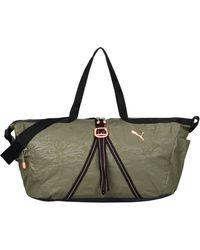 PUMA Padded Barrel Bag - Lyst 58b1a727cb060