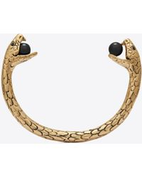 Saint Laurent - Snake Bracelet In Gold Metal With Black Glass Beads. - Lyst
